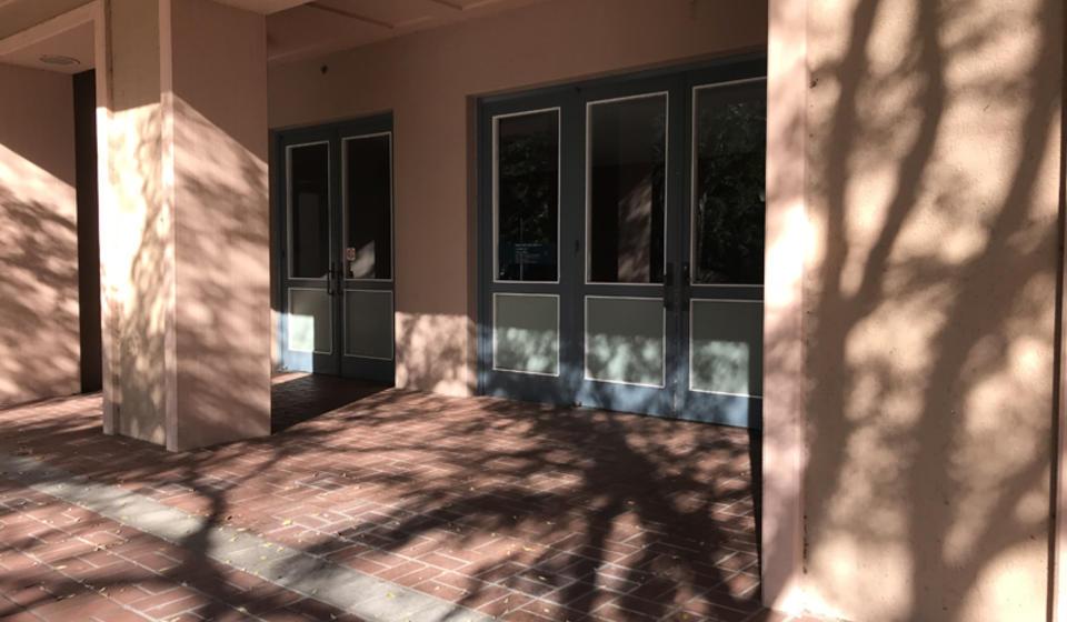 The main entrance to Hertz Hall, facing south. At the main entrance, there are three sets of manual doors.